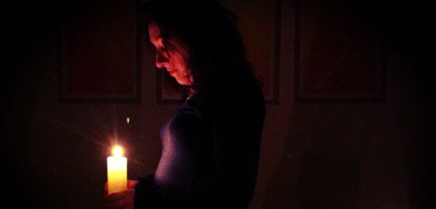 woman holding candle - illustrating a song for candlemas