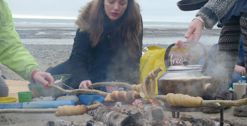 cooking twists or pinnebrød over an open fire on the beach at borth ynyslas